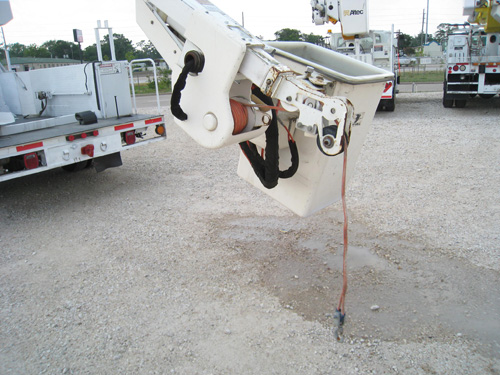 Bucket truck with boom tip winch.