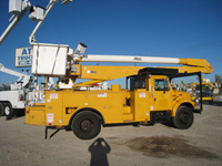 Bucket trucks with dual fuel tanks.